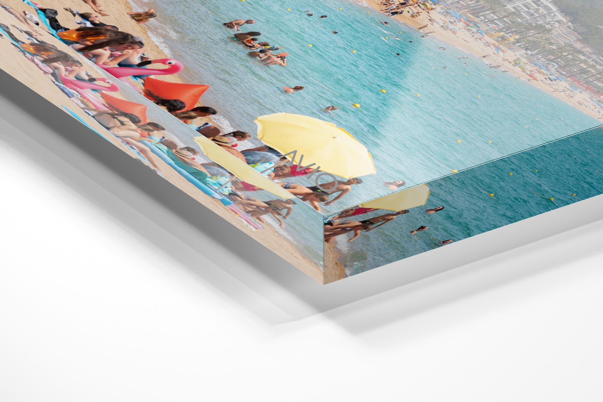 Bright colors of people and umbrellas along Lloret de Mar beach in an acrylic/perspex frame