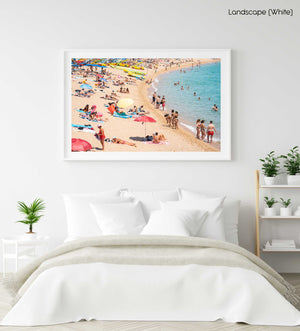 Colors of umbrellas, sand and people on Lloret de Mar beach in a white fine art frame