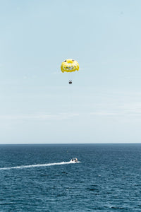 Yellow parasail behind boat in Costa Brava Spain