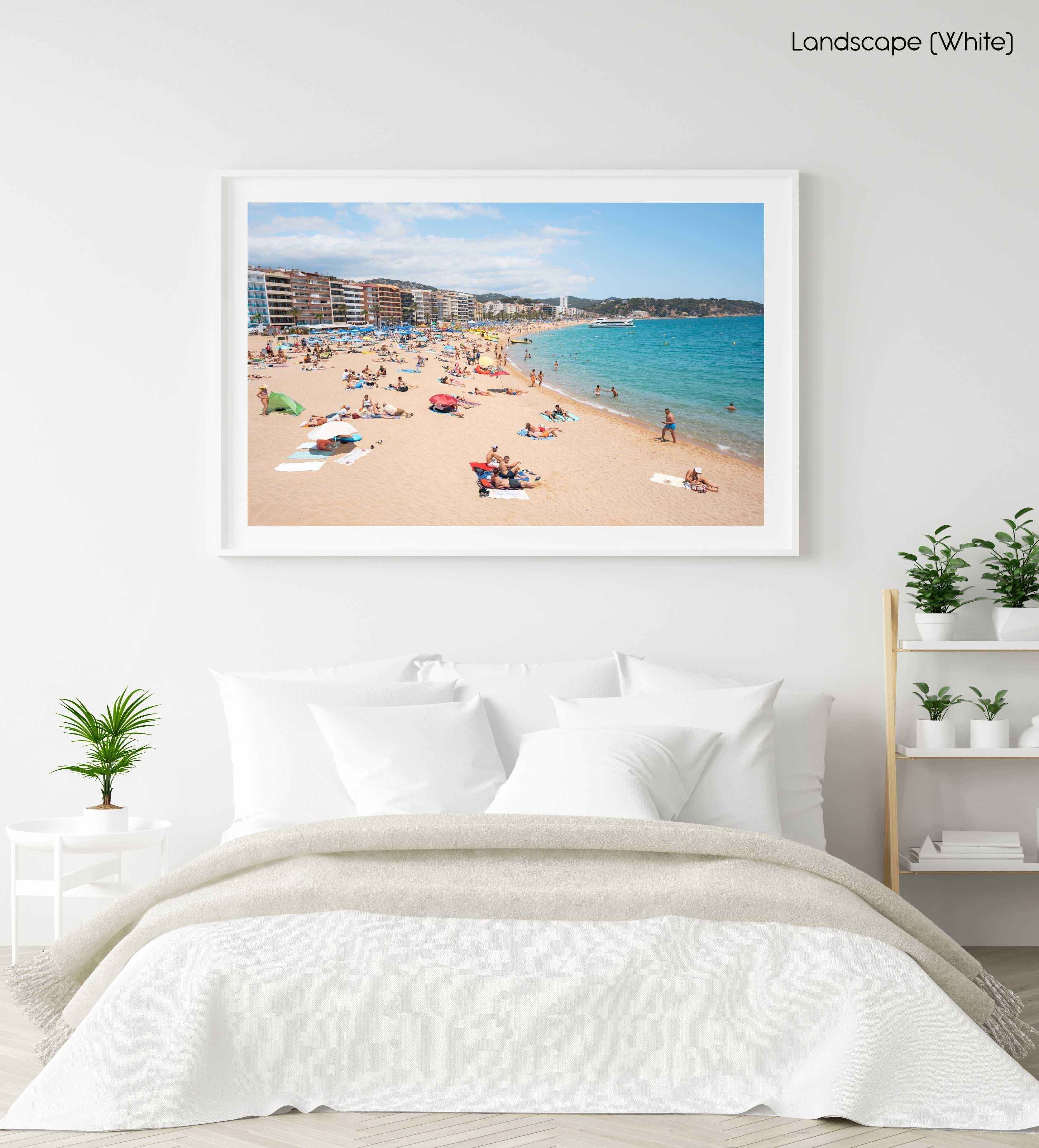 Crowded beach of Lloret de Mar with blue water in summer in a white fine art frame