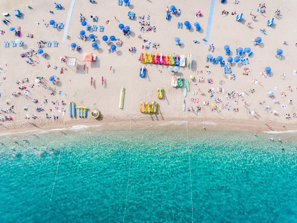 Aerial of blue water and beach goers at Lloret de Mar Costa Brava