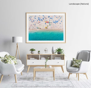 Aerial of blue water and beach goers at Lloret de Mar Costa Brava in a natural fine art frame