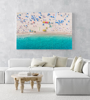 Aerial of blue water and beach goers at Lloret de Mar Costa Brava in an acrylic/perspex frame