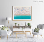 Aerial of blue ocean and people lying on Lloret de Mar beach in a natural fine art frame