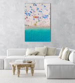 Colorful umbrellas, boats and water seen from air above Lloret de Mar beach in a white fine art frame