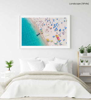 Boat parked off in blue water at Lloret de Mar beach Costa Brava in a white fine art frame