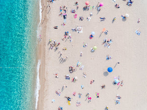 Busy beach day in Lloret de Mar during summer from aerial point