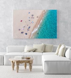 Simplistic aerial of blue ocean and people sunbathing in Costa Brava in an acrylic/perspex frame