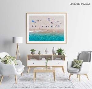 Lines of people tanning on beach in Spain from aerial view in a natural fine art frame