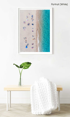 Lines of people tanning on beach in Spain from aerial view in a white fine art frame