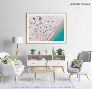 Aerial of people lying in the sun on the beach in a natural fine art frame
