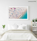 Aerial of people lying in the sun on the beach in a white fine art frame