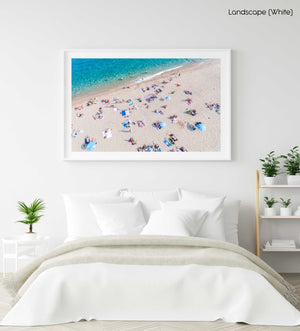 High above people swimming and tanning along Lloret de Mar beach in a white fine art frame