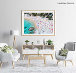 Colorful umbrellas and people lying on beach taken from the sky in a natural fine art frame
