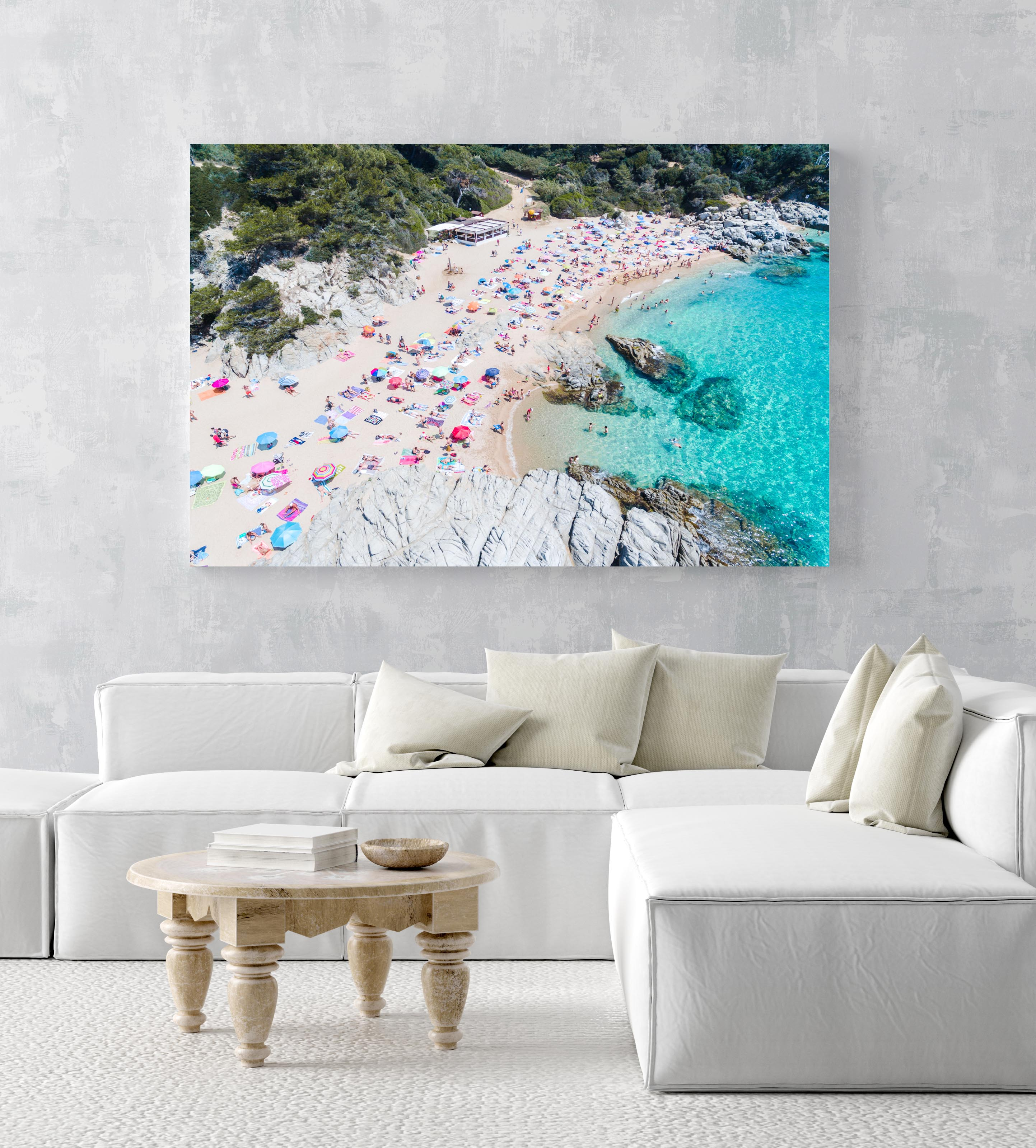 Busy beach full of people and umbrellas in Costa Brava in an acrylic/perspex frame