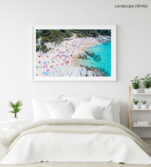 Busy beach full of people and umbrellas in Costa Brava in a white fine art frame
