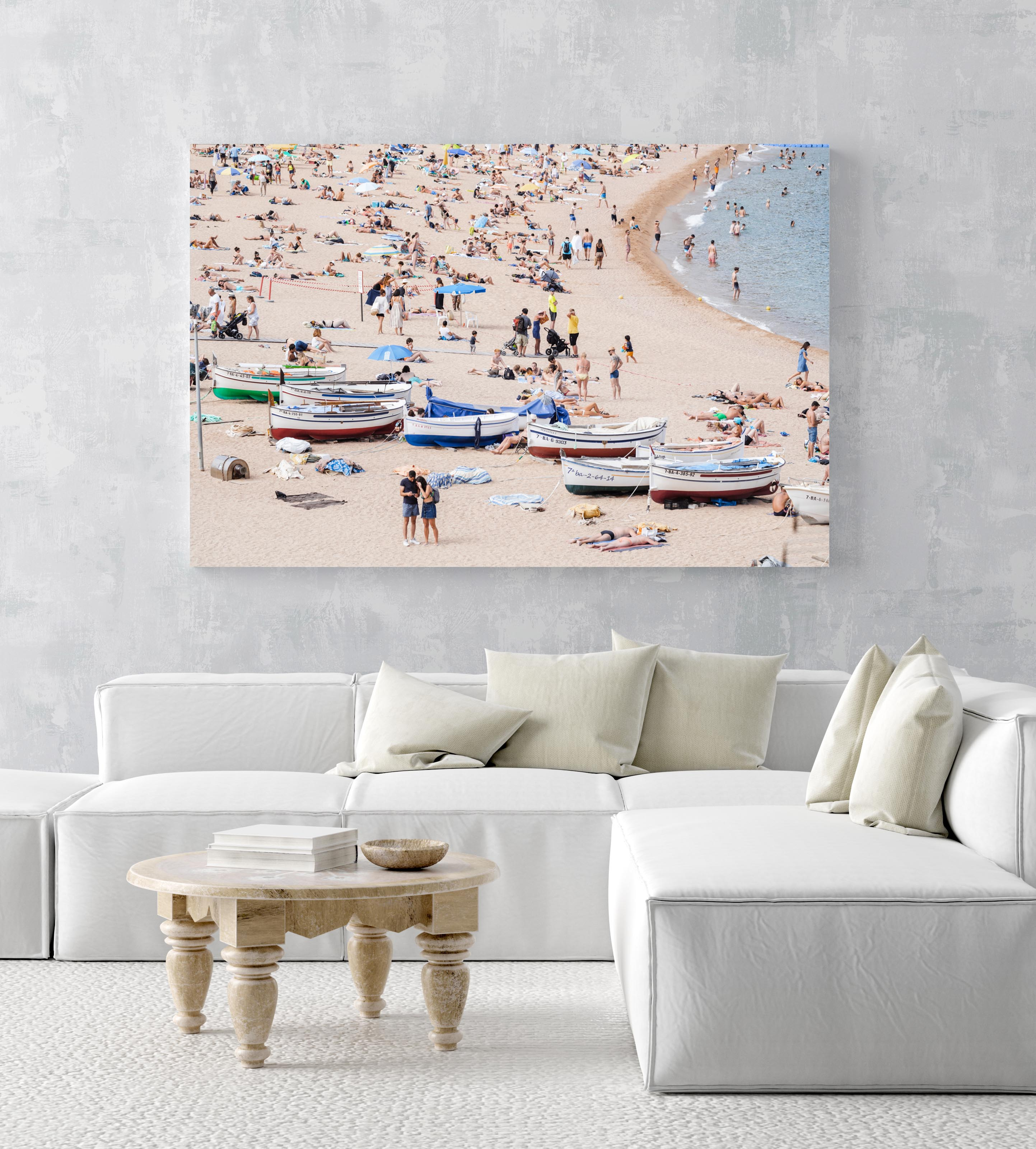 Boats and people beached along Tossa de Mar beach in an acrylic/perspex frame
