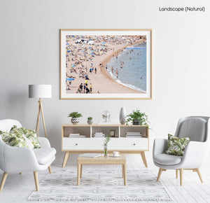 Busy beach full of people in Tossa de Mar in a natural fine art frame
