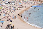 Busy beach full of people in Tossa de Mar