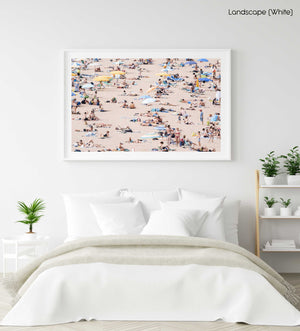 Very crowded beach full of people in Tossa de Mar in a white fine art frame