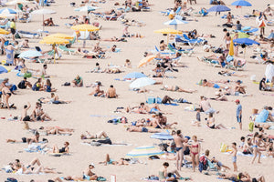 Very crowded beach full of people in Tossa de Mar