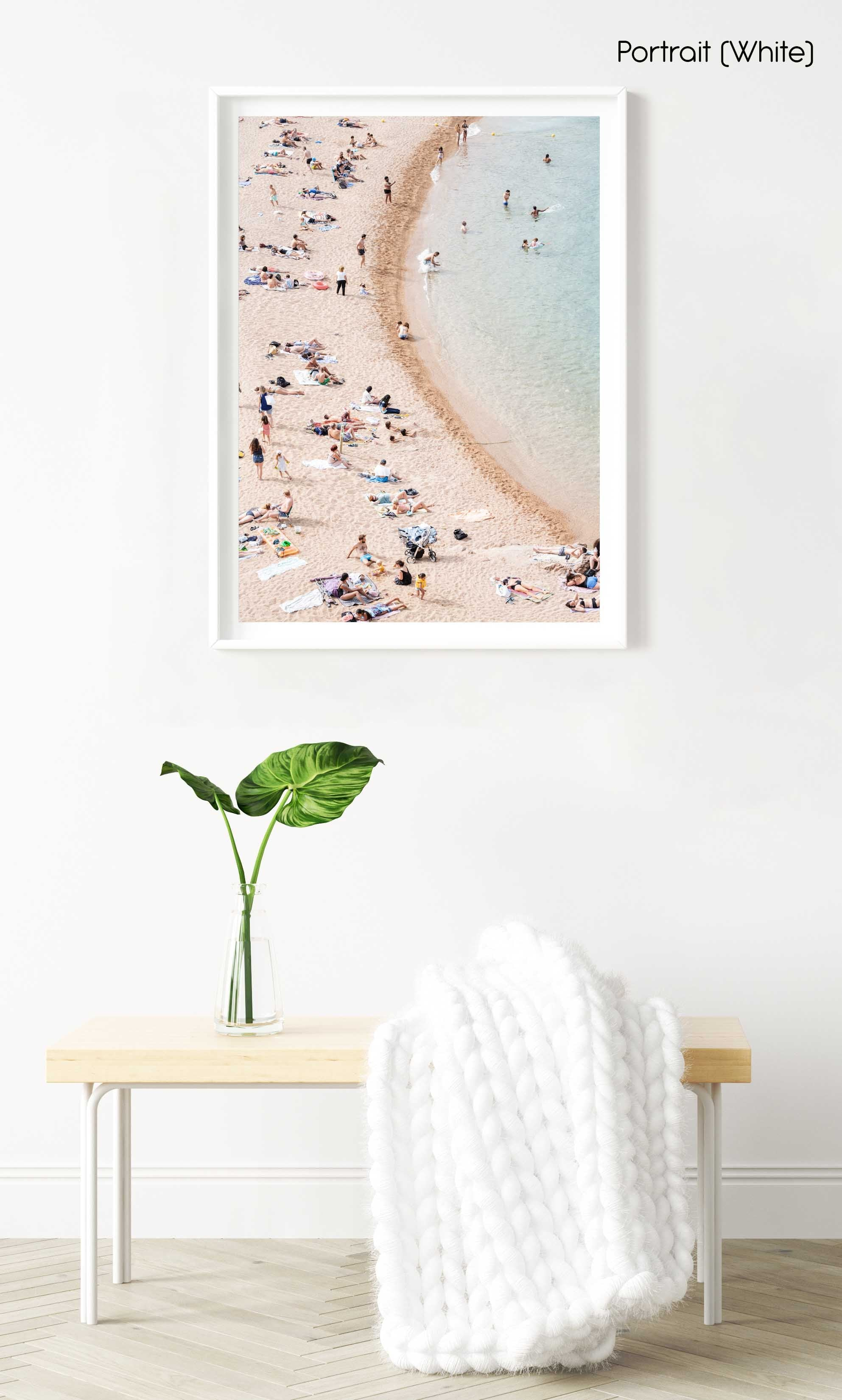 Light colors of people swimming at Tossa de Mar beach in a white fine art frame