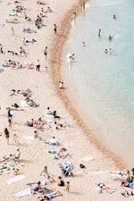 Light colors of people swimming at Tossa de Mar beach