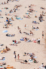 Lots of people lying on the sand in Tossa de Mar