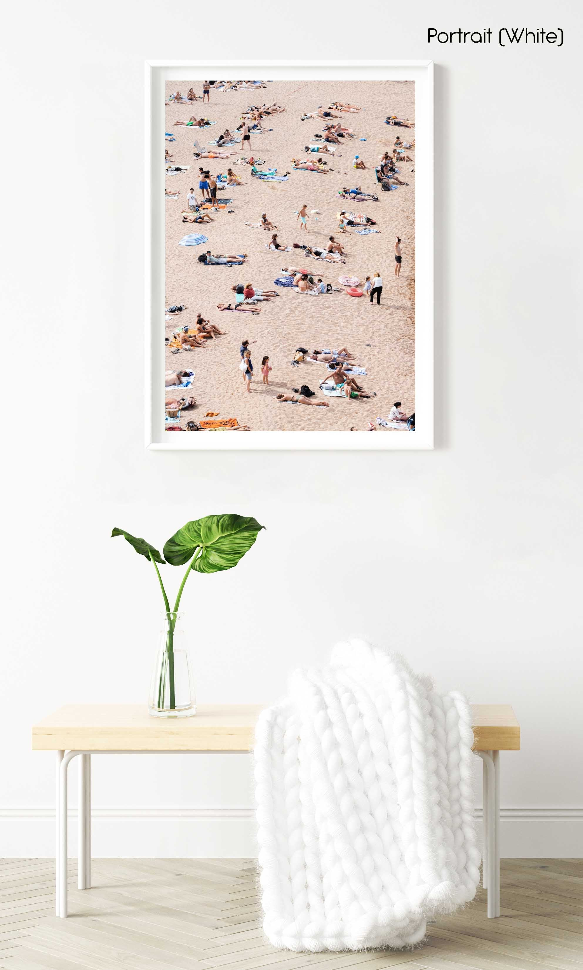 Lots of people lying on the sand in Tossa de Mar in a white fine art frame