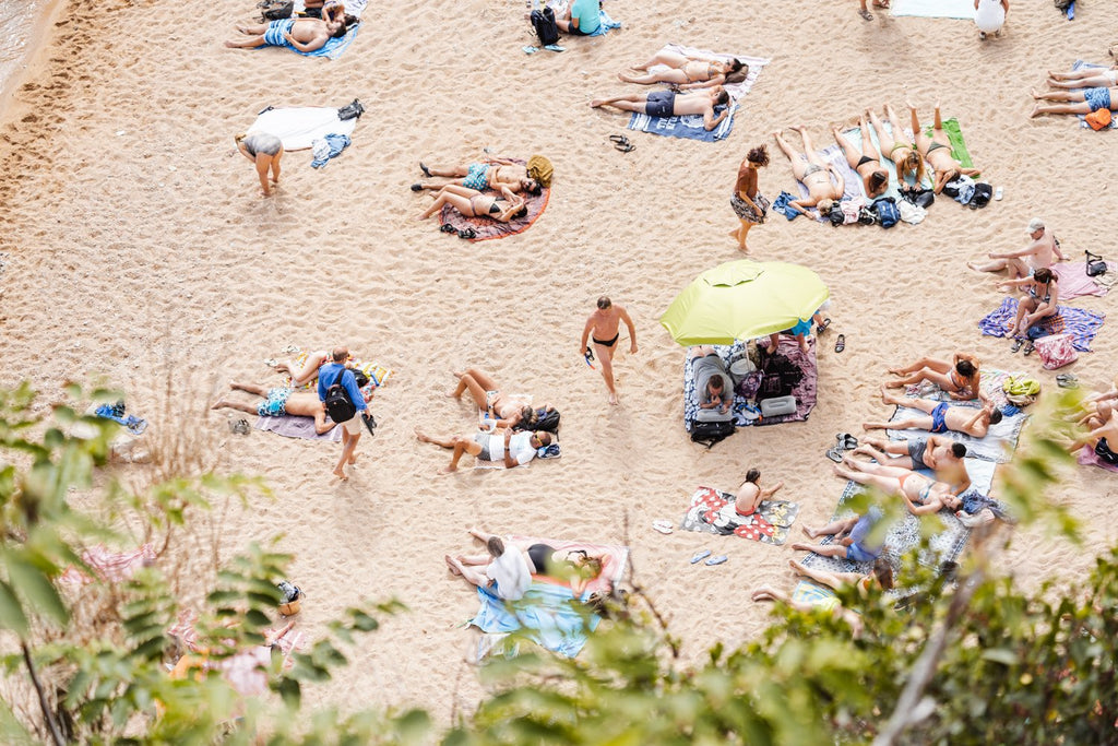 People lying on the beach from above