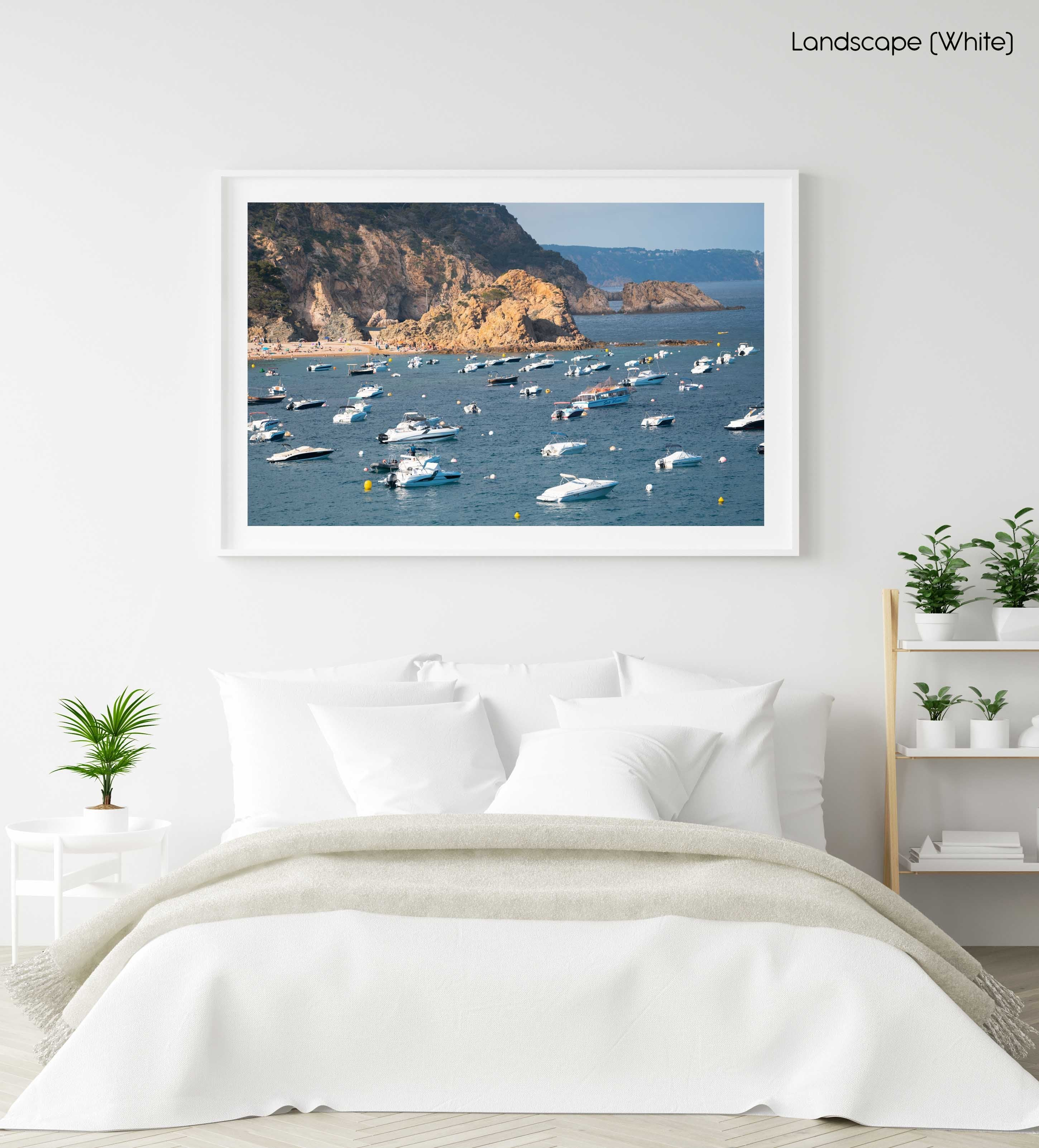 Many boats anchored off in ocean along Tossa de Mar beach in Spain in a white fine art frame