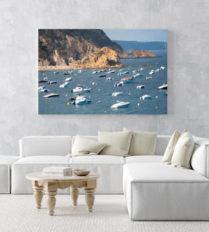 Many boats anchored off in ocean along Tossa de Mar beach in Spain in an acrylic/perspex frame