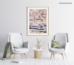 Boats and people scattered on Tossa de Mar beach in a natural fine art frame