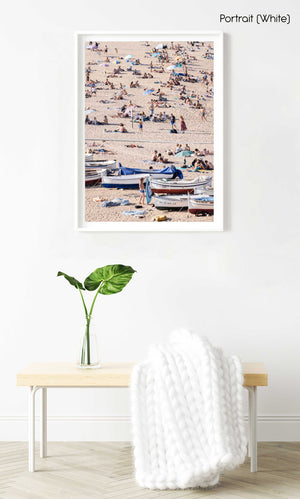 Boats and people scattered on Tossa de Mar beach in a white fine art frame