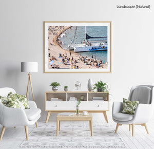 Sailing boat parked on a crowded beach in Spain in a natural fine art frame