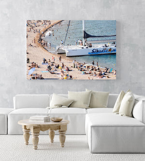 Sailing boat parked on a crowded beach in Spain in an acrylic/perspex frame