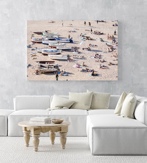People and boats lying on the sand of Costa Brava in an acrylic/perspex frame