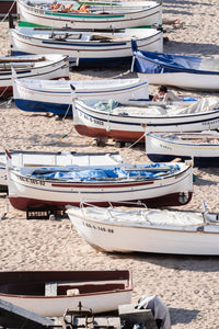 Empty boats beached on the sand