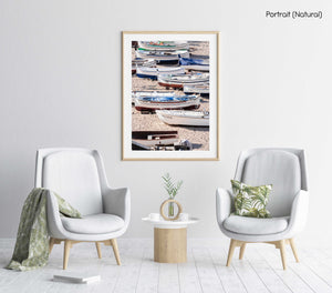 Empty boats beached on the sand in a natural fine art frame