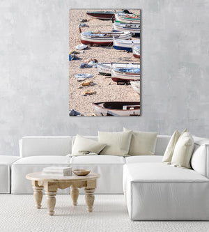 Wooden boats beached on the sand in an acrylic/perspex frame