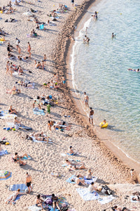 Curved sea along crowded Tossa de Mar beach
