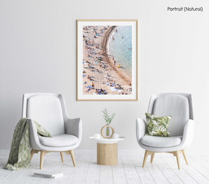 Curved sea along crowded Tossa de Mar beach in a natural fine art frame