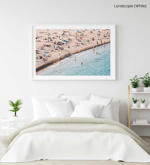 People lying on beach along calm blue sea in a white fine art frame