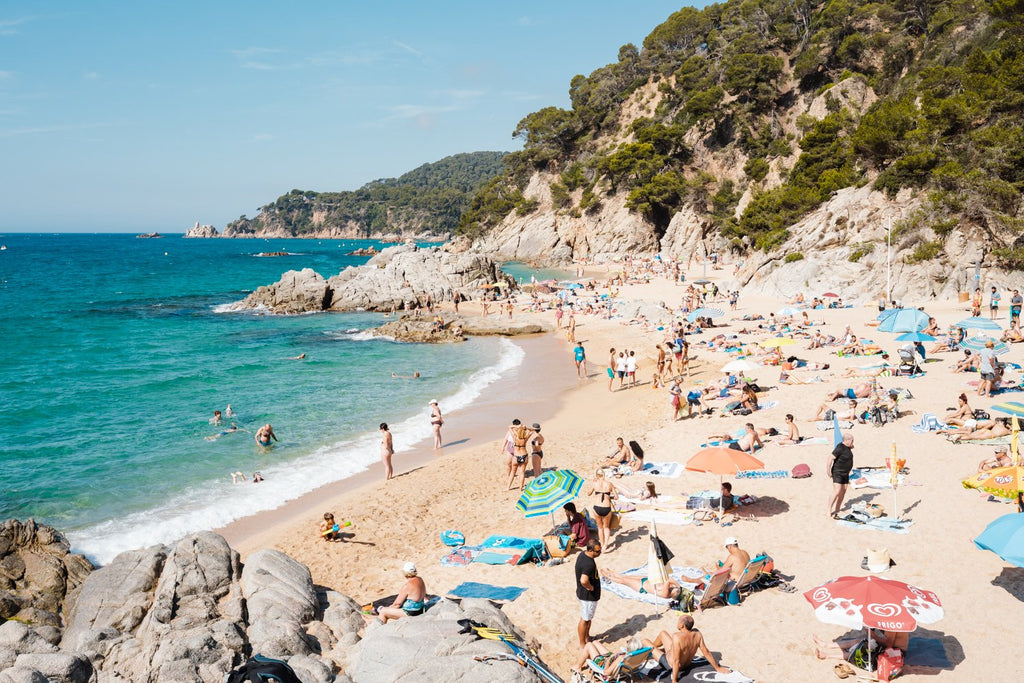 Packed beach along Costa Brava