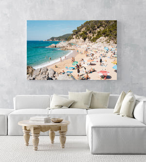 Packed beach along Costa Brava in an acrylic/perspex frame