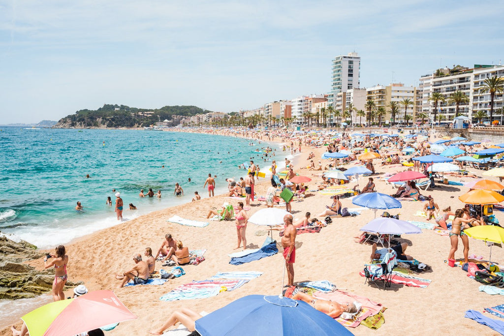 Very busy Lloret de Mar beach on summers day in June