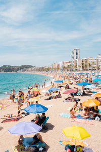 Very busy Lloret de Mar beach full of umbrellas and people