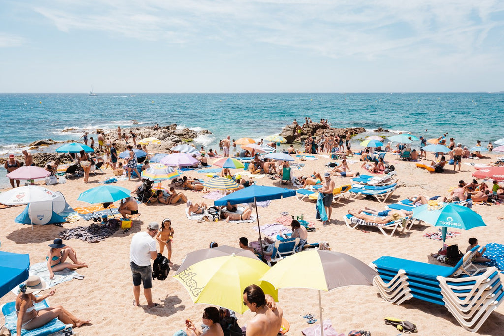 Lloret de Mar beach full of people and umbrellas