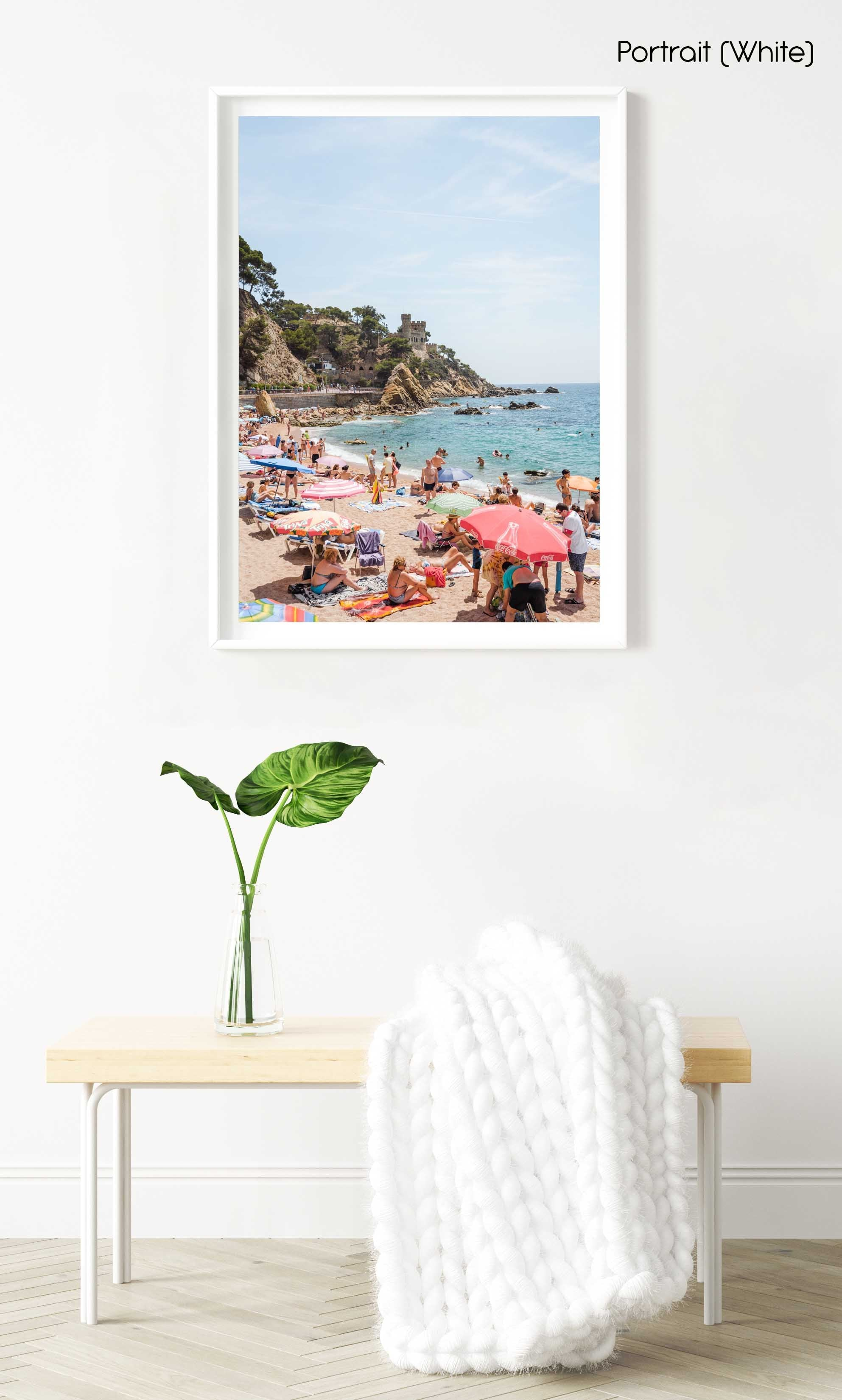 Umbrellas, people on sand and a castle along Costa Brava in a white fine art frame