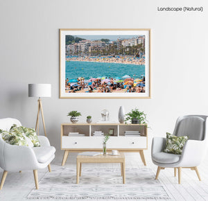 Crowds of people on either side of beaches at Lloret de Mar in a natural fine art frame